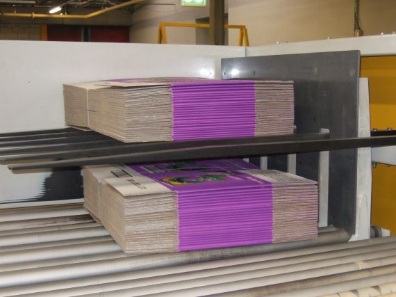 Bundle doubler holding one stack of boards above another