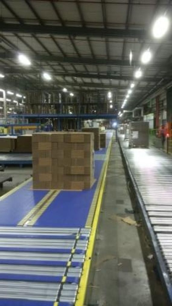 Stack of boards on a conveyor belt